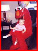 Kids party entertainer Daisy Doodle dresses as Elmo for childrens birthday parties in nyc