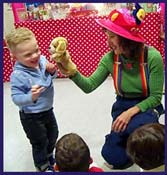 Boy is enchanted with puppy puppet during show for  kids birthday party entertainment in New York