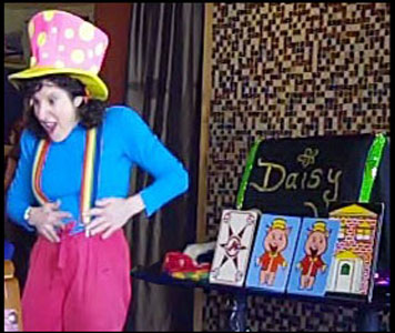 Clown magician Daisy Doodle performing a comedy clown magic show with storytelling and magic props