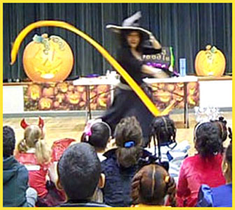 Kids party entertainer Daisy Doodle starts off her Halloween party magic show with music and props for a grand opening number