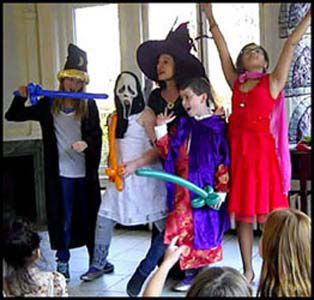 Kids pose in costume after participating in Harry Potter magic show at birthday party