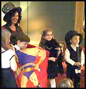 Kids enjoy being part of birthday party magic show story with props and costuming