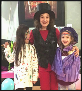 Birthday girl and her friend help magician Daisy Doodle with her magic show in Brooklyn NY