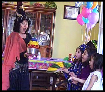 Kids are awed when wizard magician Daisy Doodle makes a birthday cake appear as finale to wizard magic show