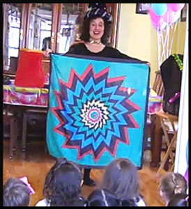 Magician Daisy Doodle produces colorful silk scarf as part of her wizard magic show in Brooklyn NY