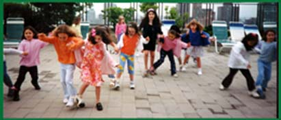 Children playing a 3-legged relay race at a kids birthday party in New York where Daisy Doodle leads fun childrens birthday party games contests and relay races.