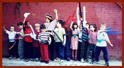Ahoy mateys!  Pirate character Daisy Doodle with kids at a childrens pirate birthday party in NYC.