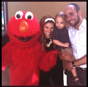 Elmo entertains toddler at his birthday party and poses for photos with the family in Brooklyn NY