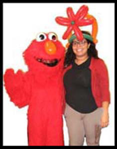 Friends sent Elmo character telegram to surprise a lady on her birthday