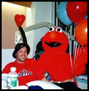 Elmo entertains man at his hospital bed on his birthday with a Elmo telegram