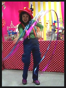 Performer Daisy Doodle's opening number with colorful props and music at 3 year old toddler birthday party