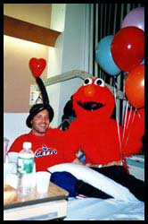 Elmo  stopped by a boys hospital room to wish him a happy birthday and get well quick.  Made him a birthday balloon hat too!