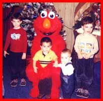 Kids surround Elmo character at this toddler childrens birthday party in Brooklyn NY.  Elmo good for babies and kids 1 year, 2 year and 3 years old.