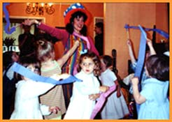 Children wave streamer wands at a Daisy Doodle's toddler dance party in nyc.