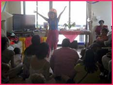 Daisy Doodle entertains children with her toddler birthday party show featuring music, dance, singalong, puppet, bubbles, props, songs