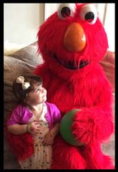 2 year old birthday girl is so happy Elmo character came to her party in Brooklyn New York.