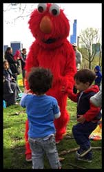 Children dance with Elmo at  toddlers birthday party in Manhattan NY