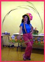 Daisy Doodle swings a giant sparkly streamer wand to begin her toddler party entertainment for kids in Queens NY