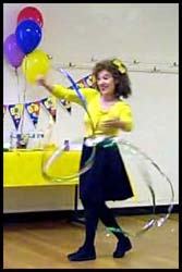 Daisy Doodle starts her Wiggles Toddler Show with a dramatic opening number with streamer wand and Wiggles music