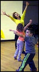 Kids stretch to Wiggles dance music with Emma character at this birthday party in New York